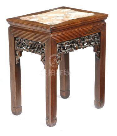 A Chinese hardwood low stand, the top inset with a marble panel, the pierced and carved frieze