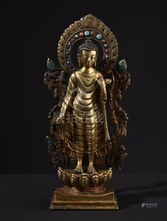 Standing Buddha Shakyamuni. Tibetan gilt bronze statue.