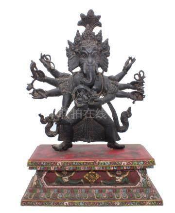 Ganesha. Impressive old Nepalese Hindu bronze statue on wood