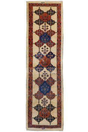 A FINE SIGNED KASHKULI RUNNER, SOUTH-WEST PERSIA approx: 9ft