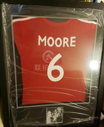 Lot 19 - Bobby Moore item containing replica red England Shi