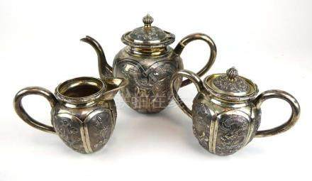 A Chinese Export metalware three piece bachelor's tea service typically relief decorated with