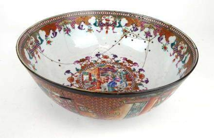An 18th century Chinese Export bowl decorated in coloured enamels with traditional court scenes, d.
