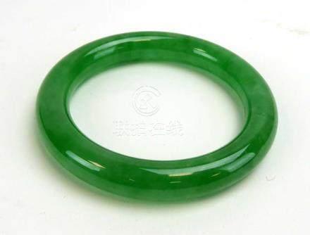 A green jade bangle, internal d. 6.