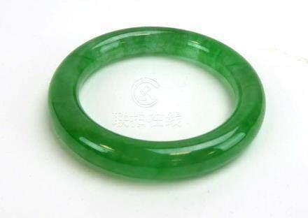 A green jade bangle, internal d. 5.