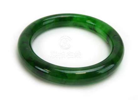 A mottled green jade bangle, internal d.
