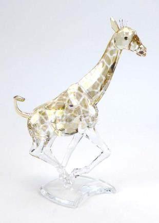 A Swarovski figure modelled as a running giraffe, h.