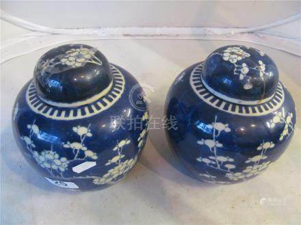 A pair of oriental ginger jars prunus blossom and other modern oriental blue and white china.