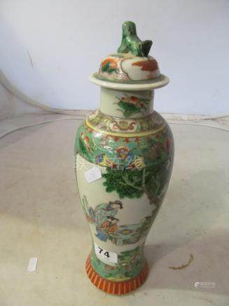 A 19th Century Famille Verte tall lidded vase scenes of figures in gardens with butterfly and floral
