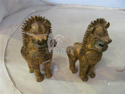 A pair of gilded metal figures Kylin Lions.