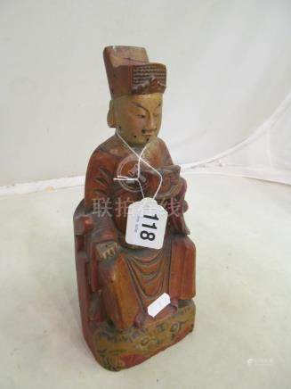 A carved and painted figure seated oriental gentleman.