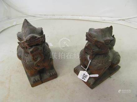 A pair of carved Kylin lions