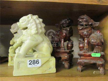 A pair of heavy Kylin Lions and a pair of bookends.