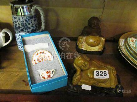 Two soapstone Buddha's on stands
