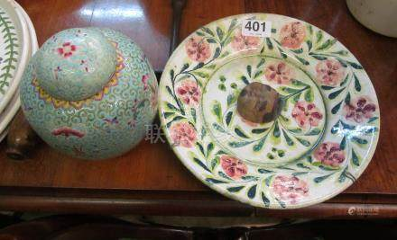 An oriental plate, small mask and ginger jar.