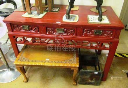 A red lacquer oriental sideboard