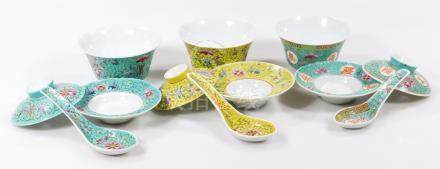 A part set of 20thC Chinese rice bowls, some with covers, in turquoise, yellow, etc, with ladles,
