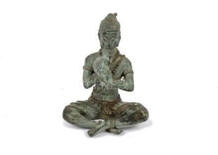 A 20th Century Thai bronze of Phra Aphai Mani crosslegged, playing his magic flute, 15 cm high