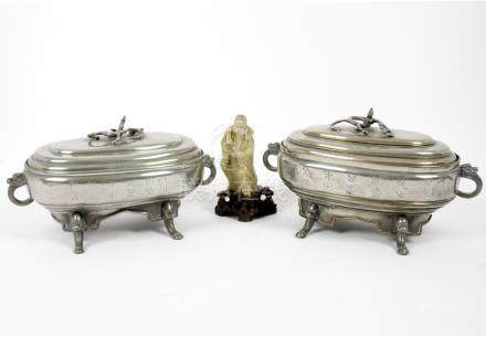 A pair of 19th Century Chinese white metal tureens and covers, dragon handles to tureens and covers,