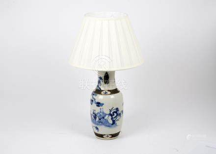 A Chinese porcelain blue and white painted lamp, decorated with applied bronze decoration and