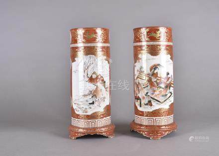 A pair of Kutani Meiji period Japanese porcelain sleeve vases, decorated with dancing females within
