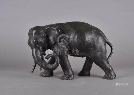 A Japanese Meiji period bronze, modelled as an elephant standing, character mark to underside, 23 cm