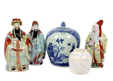 A set of 20th Century Chinese porcelain figures of the Sanxing, comprising Fu, Lu and Shou holding