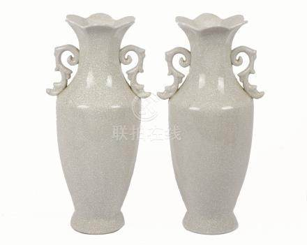 A pair of 20th Century Chinese porcelain twin-handled baluster vases, crackle glaze, flared petal