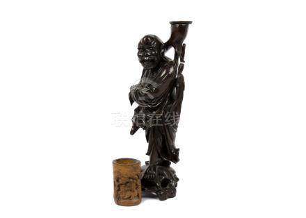 A 20th Century Chinese root carving of an old man on a naturalistic base, 42 cm high. Together