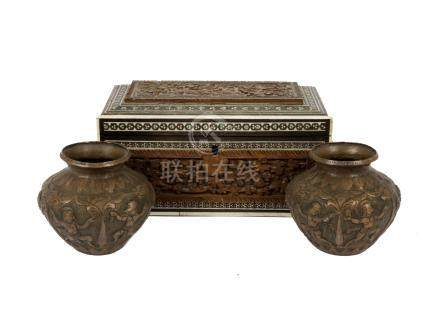 A Middle Eastern wood and ivory inlaid box, hinged lid, carved relief decoration of animals and