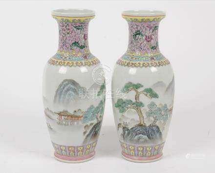 A pair of 20th Century Chinese famille rose ovoid vases, enamel lake scenes, character marks to