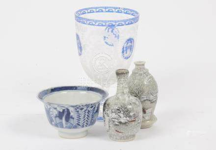 A Chinese porcelain blue and white, figure and floral decoration, character marks to base, 5 cm