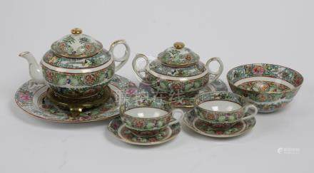 20th century Chinese tea service, painted with flowers and foliage, consisting of 12 teacups,