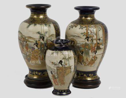 Three early 20th century Imari vases, each with two panels depicting Asian figures within a