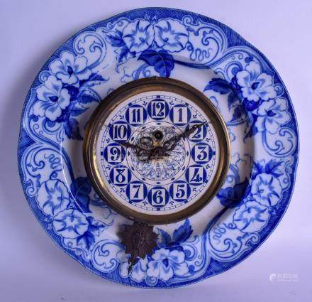 AN UNUSUAL FRENCH BLUE AND WHITE CIRCULAR POTTERY CLOCK