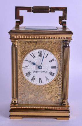 A MAPPIN & WEBB CARRIAGE CLOCK with scrolling foliate