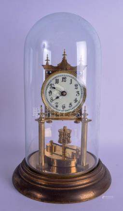 A BRASS ANNIVERSARY CLOCK within a glass dome. Clock 26