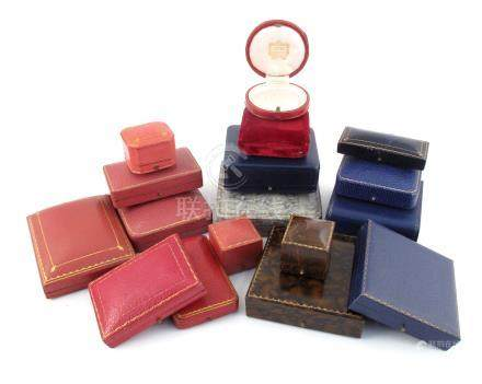 A collection of seventeen antique jewellery boxes, including a circular case by Cartier, a fitted