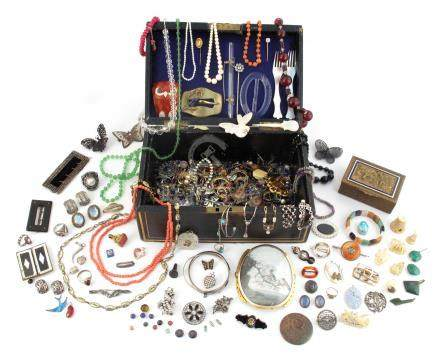 A jewellery casket containing various items of jewellery etc., including a large clasp containing an