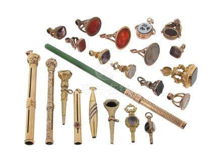 A collection of gold propelling pencils and fob seals, including a ruby and diamond-set gold pencil,