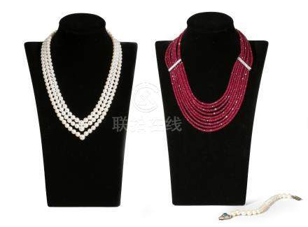 A nine-row ruby bead necklace, separated with diamond-set spacers with white gold clasp, 50cm
