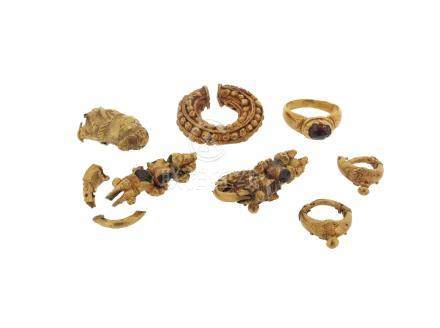 A faceted red stone-mounted gold ring in the classical manner, with case, and various gold items and
