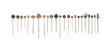 Twenty-three assorted stick pins, of various designs including an owl, a dogs mask and some set with