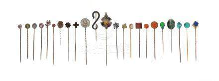 Twenty-two assorted stick pins, set with stones including a garnet, opal, ruby and turquoise From