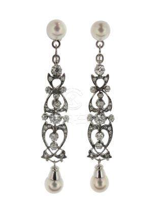 A pair of cultured pearl and diamond drop earrings, the modern cultured pearl studs suspend