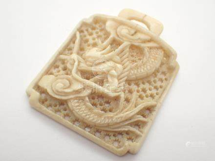 Antique hand carved ivory toggle with dragon