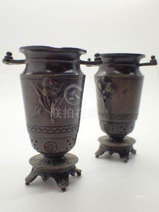 Pair of Japanese cast bronze vases on splayed feet