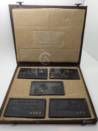 Cased set of five Oriental plaques