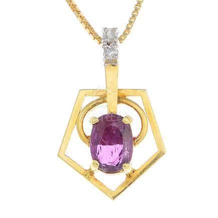 A ruby and diamond pendant.