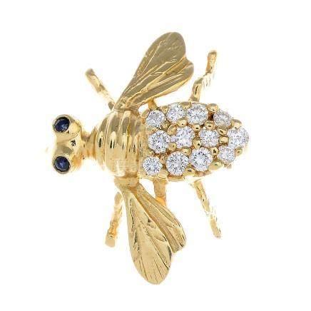 A diamond and sapphire bee brooch.